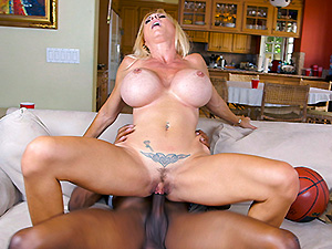 Horny MILF takes on 2 basketball studs image 6